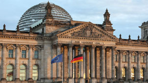 Buildings of the Reichstag with flag of Germany and European Union
